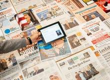 Man holding iPad with Donald Trump wikipedia Stock Photos