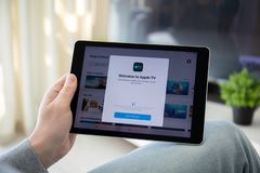 Man holding iPad Pro with Apple TV app on the screen. Anapa, Russia - March 29, 2019: Man holding iPad Pro with Apple TV app provides streaming movies and cable royalty free stock photo