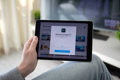 Man holding iPad Pro with Apple TV app on the screen. Anapa, Russia - March 29, 2019: Man holding iPad Pro with Apple TV app provides streaming movies and cable stock image