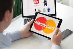 Man holding iPad Pro payment system service MasterCard on screen Stock Photography