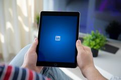 Man holding iPad Pro with social network service LinkedIn. Anapa, Russia - March 29, 2019: Man holding iPad Pro with social network service LinkedIn on the royalty free stock photography