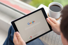 Man holding iPad Pro Space Gray with social networking Google Stock Photo