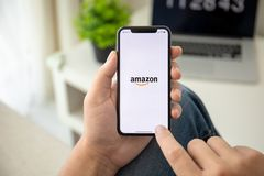 Man holding iPhone X with Internet shopping service Amazon. Alushta, Russia - July 29, 2018: Man holding iPhone X with Internet shopping service Amazon on the royalty free stock images
