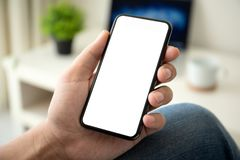 Free Man Holding IPhone X With Service PayPal On The Screen Royalty Free Stock Photos - 125715858