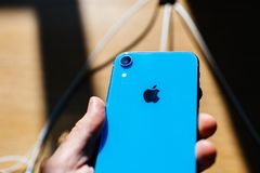 Man holding iphone Xr blue color royalty free stock image