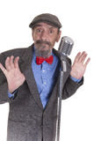 Man holding jacket collar. Ma wearing newsboy hat and red bow tie holding jackets collar Stock Images