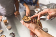 Man holding jar with coffee beans Stock Photo