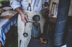 Man Holding Jar While Scooping on Kettle Royalty Free Stock Photos