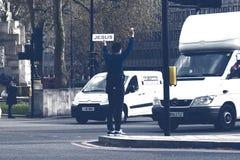 Man Holding Jesus Sign. Royalty Free Stock Image