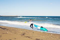 Man holding kayak oar against the sea Royalty Free Stock Image