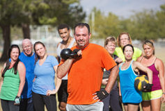 Man Holding Kettle Bell Weight Stock Image