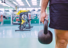 Man holding kettlebell in a crossfit training Stock Image