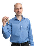Man holding key Royalty Free Stock Photography