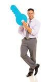 man holding key symbol Stock Image