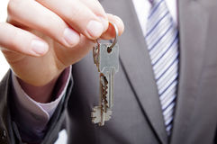 Man holding keys. Real estate agent giving keys to a customer Royalty Free Stock Photos
