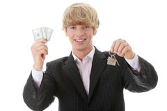 Man holding keys and moneys Stock Photo