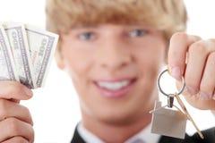 Man holding keys and moneys Stock Image