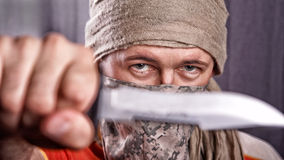 Man holding knife Royalty Free Stock Photo