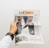 Man holding La Croix newspaper with Emmanuel Macron on first pag Royalty Free Stock Photography