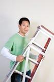 Man holding ladder Stock Photo