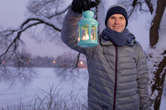 Man holding lantern with candle outdoors Royalty Free Stock Photography