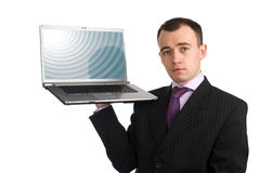 Man holding a laptop Stock Photo