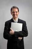 Man holding laptop Stock Images