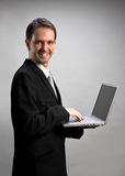 Man holding laptop Stock Images