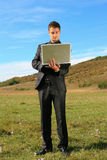 Man holding a laptop Stock Image