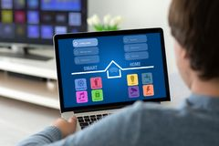 Man holding laptop with app smart home on the screen. In the house in the room royalty free stock image