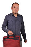 Man holding a laptop bag. Young attractive man is holding a laptop bag isolated on white Stock Photo