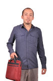 Man holding a laptop bag. Young attractive man is holding a laptop bag isolated on white Stock Images