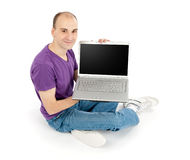 Man holding laptop computer. Happy young man holding laptop computer with blank screen Stock Photography