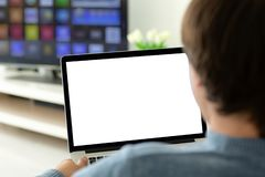 Man holding laptop with  screen in the room. Man holding laptop with  screen in the house in the room stock photo