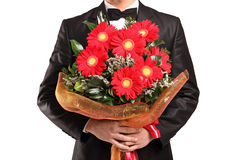 A man holding a large bouquet of flowers Stock Image