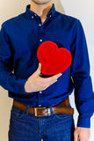 Man holding a large red symbol heart in hands Royalty Free Stock Photos