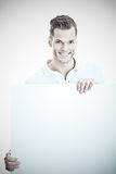 Man holding large white board Royalty Free Stock Images