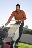 Man Holding A Lawn Mower Stock Photos