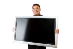 Man holding lcd tv Royalty Free Stock Photo