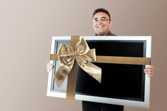 Man holding lcd tv Royalty Free Stock Images