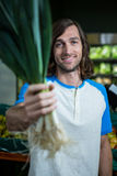 Man holding leafy vegetable in supermarket Royalty Free Stock Photo