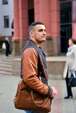 Man holding leather bag on his shoulder royalty free stock photos