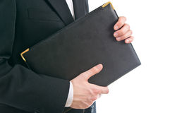 Man holding leather folder Royalty Free Stock Photos