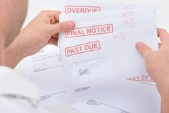 Man holding legal notices Royalty Free Stock Image