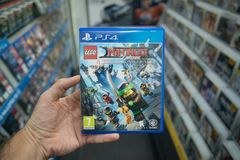 Man holding Lego Ninjago videogame on Sony Playstation 4 console in store. Bratislava, Slovakia, october 2 2017: Man holding Lego Ninjago videogame on Sony Royalty Free Stock Photo