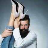 Man holding legs of woman Stock Image