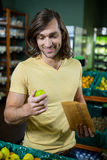 Man holding lemon in supermarket Royalty Free Stock Image