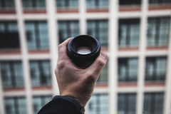 Man holding lens Royalty Free Stock Photo