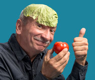 Man holding lettuce and tomato Stock Image