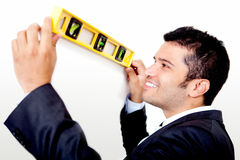 Man holding level instrument Royalty Free Stock Photo